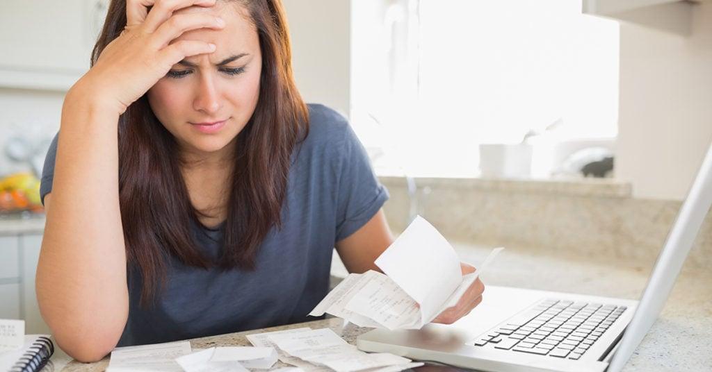 woman struggling to manage debt bills