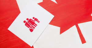 canadian flag with sign family holding money